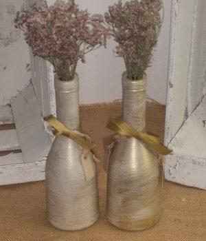 Media botella en color crema con terminación dorado viejo