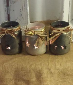 Pot estrellitas vela, colores gris grafito y yute.